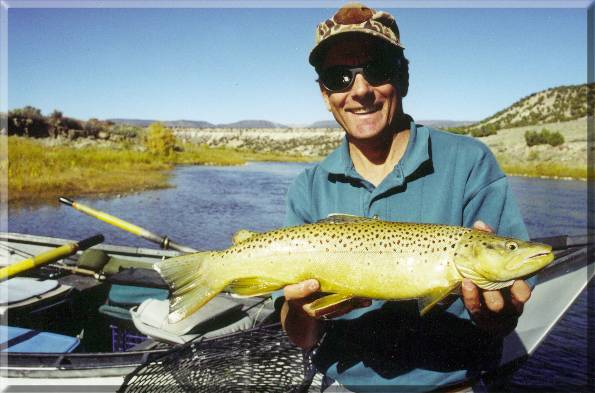 Steve Dotson show off his Shangri-La Brown Trout
